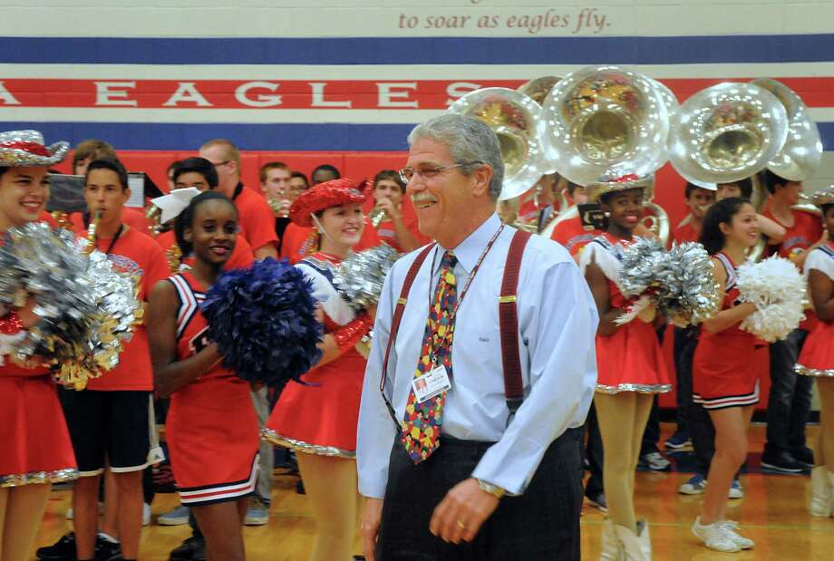 A surprised Humble ISD Superintendent Doctor Guy Sconzo walks past Atascocita High School cheerleaders, drill team and band members during a surprise pep rally for Sconzo at Atascocita High School. Humble ISD staff hosted the pep rally to celebrate Sconzo being named Superintendent of the Year for Region 4, which includes more than 50 school districts in the Houston area.  Photo: David Hopper, For The Chronicle / freelance