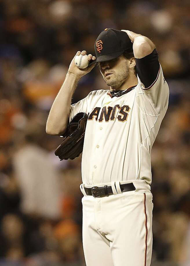 San Francisco Giants pitcher Barry Zito adjusts his cap after Los Angeles Dodgers' Carl Crawford singled during the fourth inning of a baseball game in San Francisco, Wednesday, Sept. 25, 2013.  Photo: Jeff Chiu, Associated Press