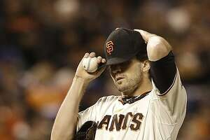 San Francisco Giants pitcher Barry Zito adjusts his cap after Los Angeles Dodgers' Carl Crawford singled during the fourth inning of a baseball game in San Francisco, Wednesday, Sept. 25, 2013. (AP Photo/Jeff Chiu)