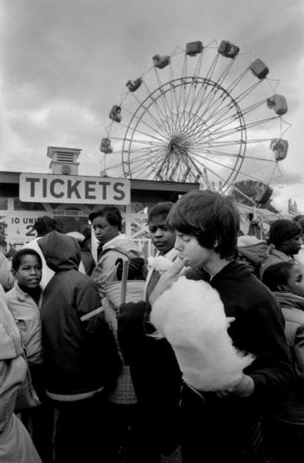 The Danbury Fair attracted more than 40,000 people on Oct. 3, 1981. Mark Schwartz, right, of Brooklyn, N.Y., was one of many who enjoyed the cotton candy on the first day of the last year of the fair. Food, music, amusement rides and animal shows continued at the fair through Oct. 12, 1981.
