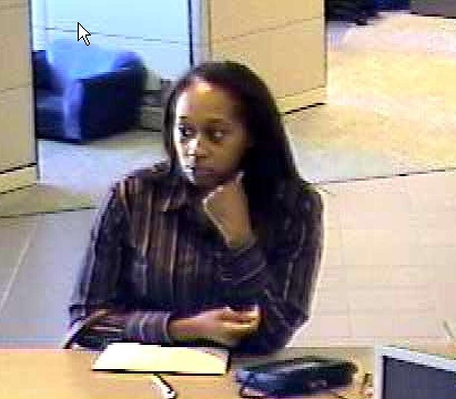 The Colonie Police Department is attempting to identify three suspects involved in multiple credit union loan scams in Colonie and Niskayuna. Photo shows a suspect at the Latham branch of the Capital Communications Federal Credit Union. (Colonie Police Department)