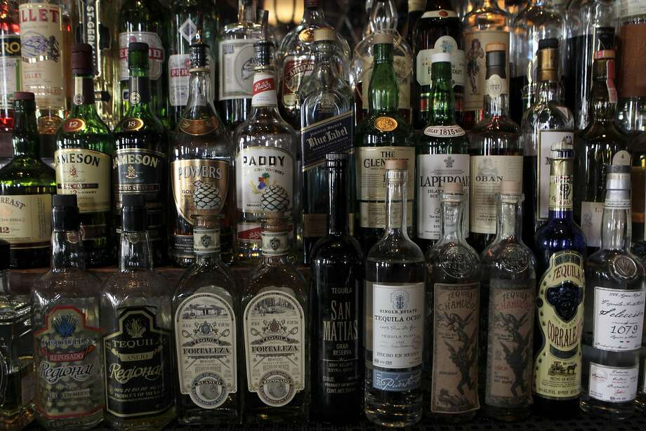 Bottles of liquor are displayed behind the counter at the Tempest bar and restaurant in San Francisco, Calif. on Tuesday, March 12, 2013. Sen. Mark Leno is introducing a bill in Sacramento that would allow bars to serve alcohol until 4 a.m. Photo: Paul Chinn, The Chronicle