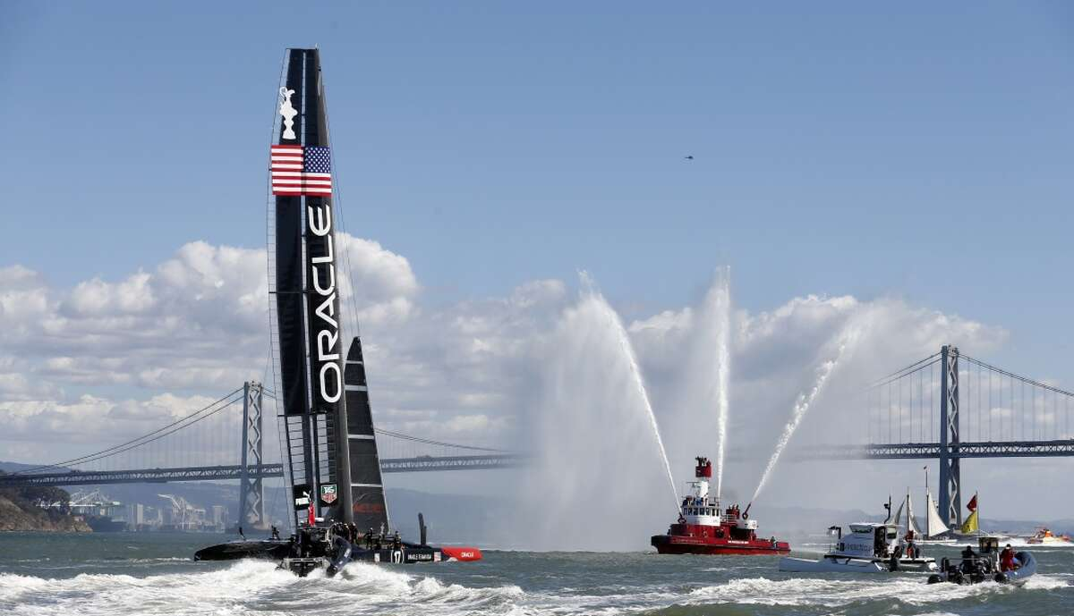 Oracle Team USA celebrates after winning Race 19 to take the America's Cup trophy on Wednesday, September 25, 2013 in San Francisco, Calif.