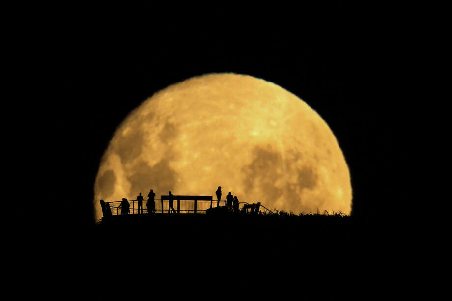 """Mark Gee, """"Moon Silhouettes""""Winner - People and Space Category Photo: Astronomy Photographer Of The Year 2013 Exhibition At The Royal Observatory Greenwich"""
