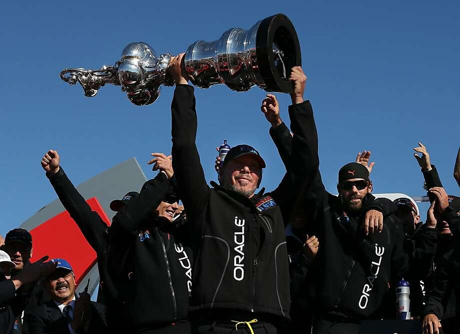Larry Ellison hoists the America's Cup trophy on Wednesday. Photo: Justin Sullivan, Getty Images