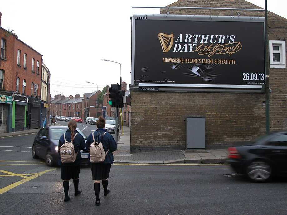 A billboard in Dublin, Ireland, promotes Arthur's Day, a celebration honoring the founder of Guinness Beer. Critics say the event celebrates alcoholism. Photo: Shawn Pogatchnik, Associated Press