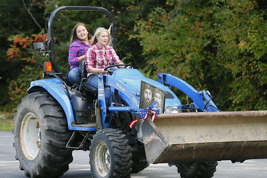 We can't drive cars yet - but heavy machinery? Heck, yeah!Eden High School students Rachel Reinecke and   Elizabeth Lemieux, both 13, operate a front-end loader down Schoolview Road during the annual Tractor Parade in   Eden, N.Y. Photo: Derek Gee, Associated Press