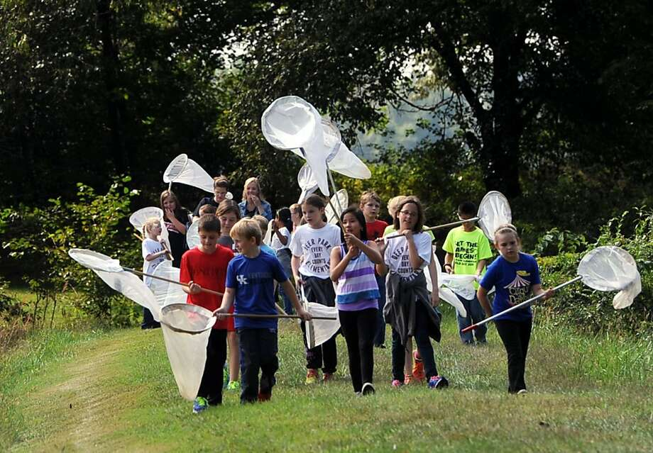 A-hunting we will go:Deer Park Elementary School fourth-graders form a monarch butterfly posse at the   Owensboro Community and Technical College Nature Center in Owensboro, Ky. Photo: Gary Emord-Netzley, Associated Press