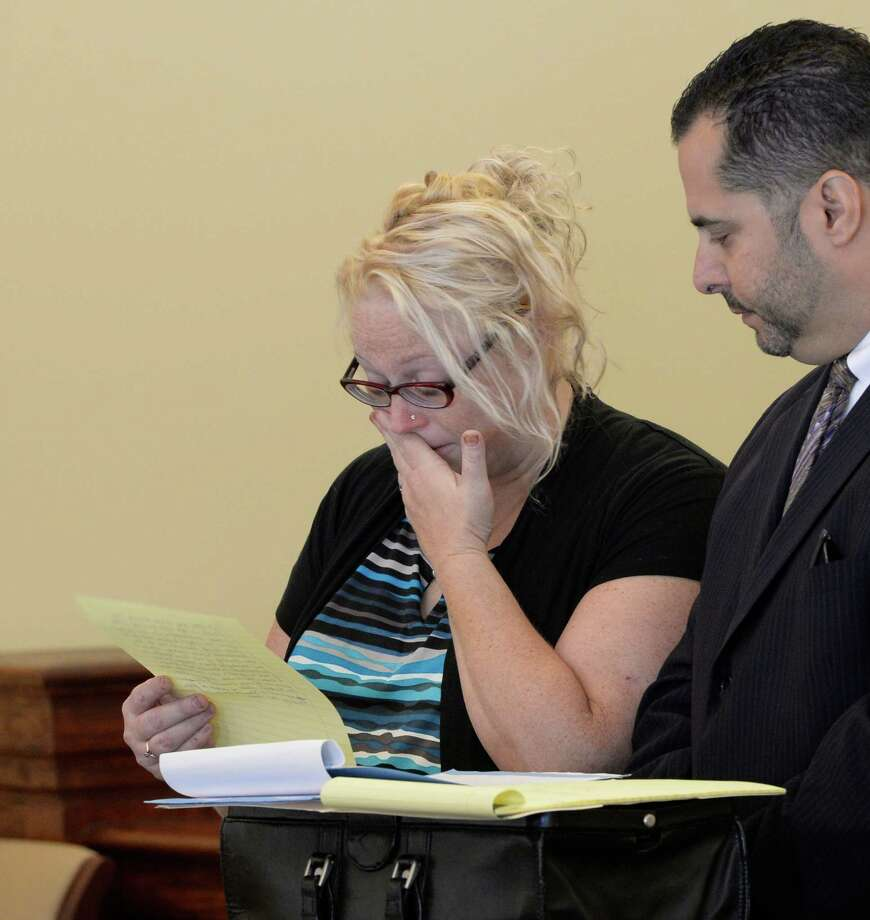 Becky Goodermote, 38, of Hoosick, is overcome by emotion as she took a plea bargain Thursday afternoon, Sept 16, 2013, in Rensselaer County Court in Troy, N.Y. Goodermote was charged with manslaughter, driving while impaired by drugs and leaving the scene of a Labor Day 2012 crash that killed a bicyclist. Standing with her is her attorney Michael Jurena. Goodermote's car, hit Matthew Ratelle, 40, of Petersburgh. (Skip Dickstein / Times Union) Photo: Skip Dickstein / 00024019A