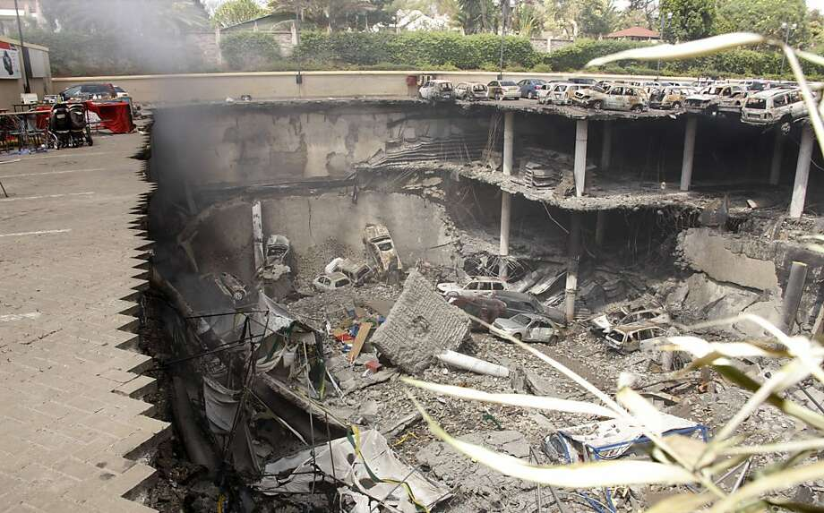 Garage turned into crater:A photo released by the Kenya Presidency shows the collapsed upper car park of the Westgate Mall in Nairobi following a terrorist attack that killed more than 60 people. Working near bodies crushed by rubble in the bullet-scarred, scorched mall, FBI 