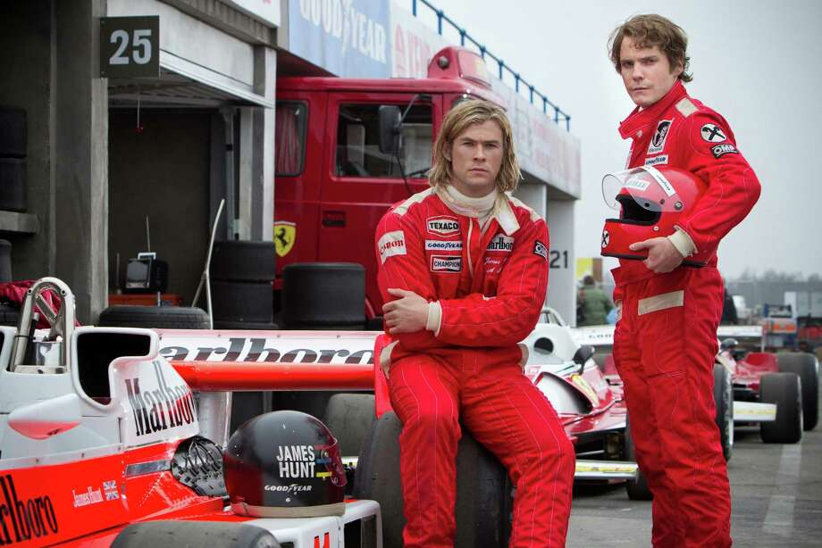 "This image released by Universal Pictures shows Chris Hemsworth, left, and Daniel Bruhl in a scene from ""Rush."" (AP Photo/Universal Pictures, Jaap Buitendijk) ORG XMIT: NYET940 Photo: Jaap Buitendijk / Universal Pictures"