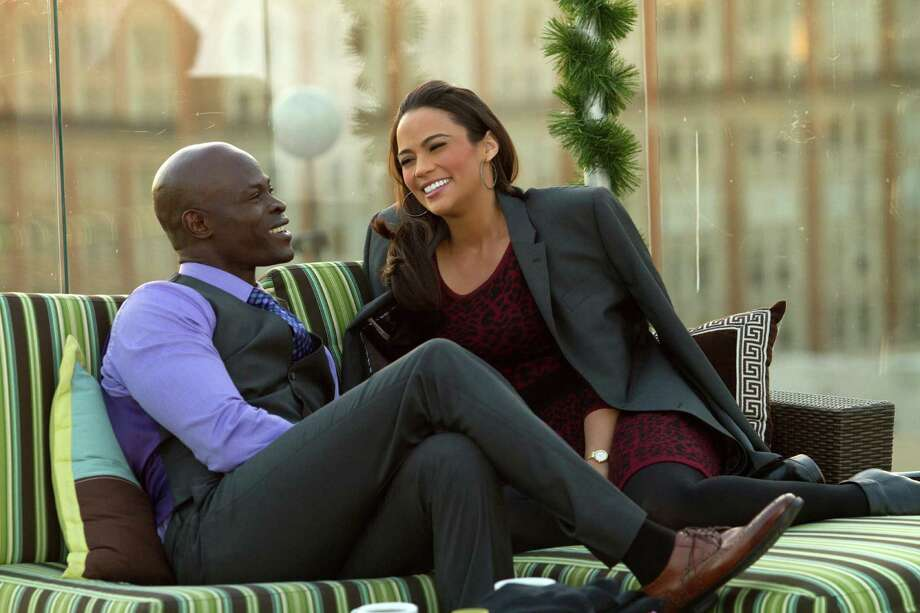 "This film image released by Fox Searchlight shows Djimon Hounsou, left, and Paula Patton in a scene from ""Baggage Claim."" (AP Photo/Fox Searchlight) ORG XMIT: NYET817 Photo: Tony Rivetti Jr. SMPSP / Fox Searchlight"