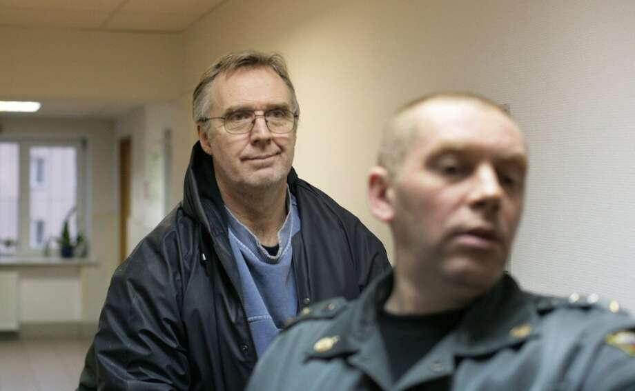 Greenpeace International Radio operator Colin Russell from Australia is escorted in a court in the northern Russian city of Murmansk. A Russian court ordered ordered 13 Greenpeace activists to be detained for two months over a high seas protest against Arctic oil drilling, in a criminal case that has caused international concern. Photo: IGOR PODGORNY, AFP/Getty Images