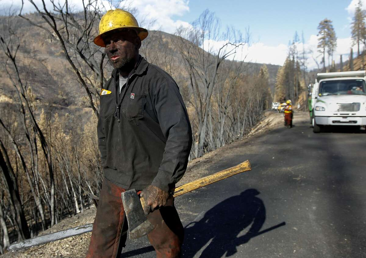 Damon Spigelman with San Francisco's public utilities commission natural resources department with a crew working along Cherry Lake Road removing dangerous burned trees near Groveland, Calif., on Wednesday Sept. 25, 2013, following the massive Rim Fire which erupted on August 17, 2013 and has burned more than 257,000 acres.