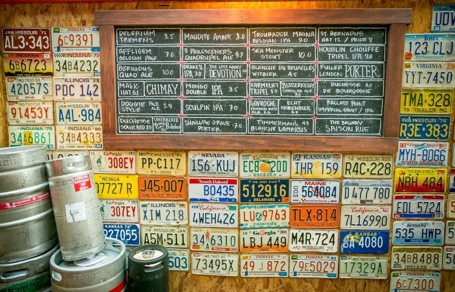 The beer menu with a wall of license plates at Garaje in San Francisco. Photo: John Storey, Special To The Chronicle