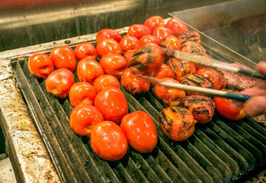 Roma tomatoes being grilled at Garaje in San Francisco. Photo: John Storey, Special To The Chronicle