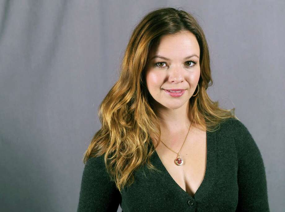 "This Sept. 18, 2013 photo shows actress Amber Tamblyn in New York. Tamblyn will guest star as Charlie Harper's daughter in the upcoming season of the comedy series ""Two and a Half Men,"" premiering Thursday, Sept 26 at 9:30 p.m. on CBS. (Photo by Diane Bondareff/Invision/AP) ORG XMIT: NYET366 Photo: Diane Bondareff / Invision"