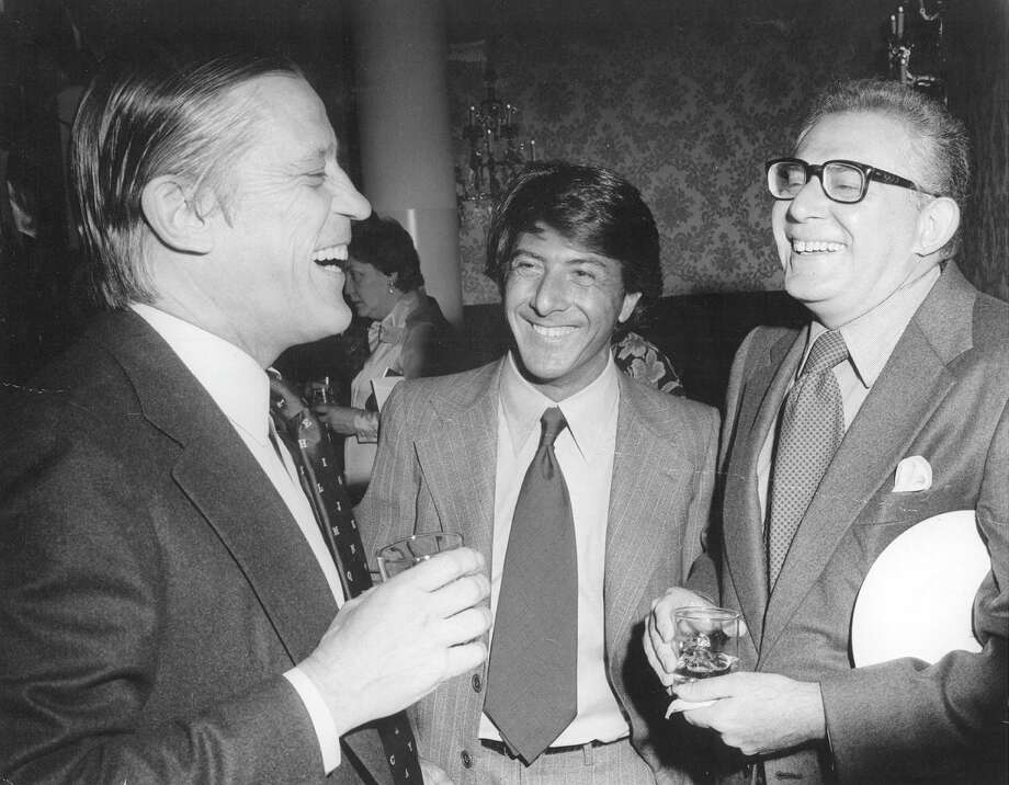 "At the Kennedy Center reception before the premiere of ""All the President's Men."" Dustin Hoffman tells a very funny, dirty joke to Ben Bradlee and Harry Rosenfeld, who appreciated the actor's sense of humor. (The Washington Post)"