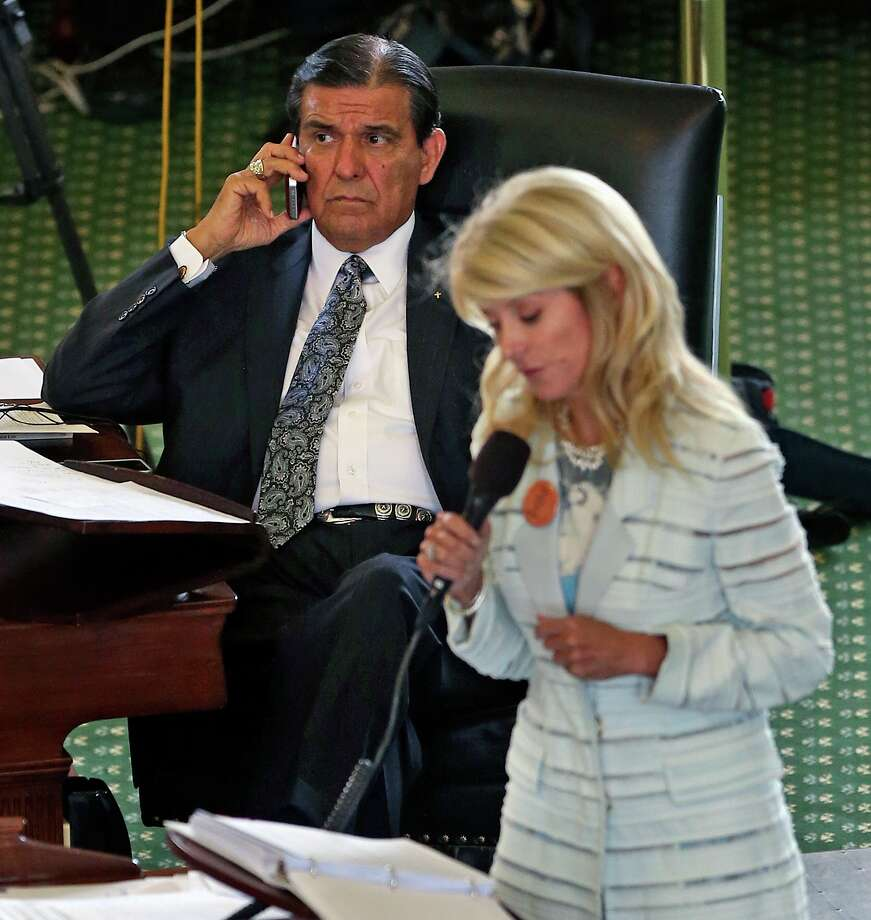 Senator Eddie Lucio D- Brownsville takes a call as Fort Worth Senator Wendy Davis filibusters in an effort to cause abortion legislation to die without a vote on the floor of the Senate Tuesday, June 25, 2013. Photo: TOM REEL