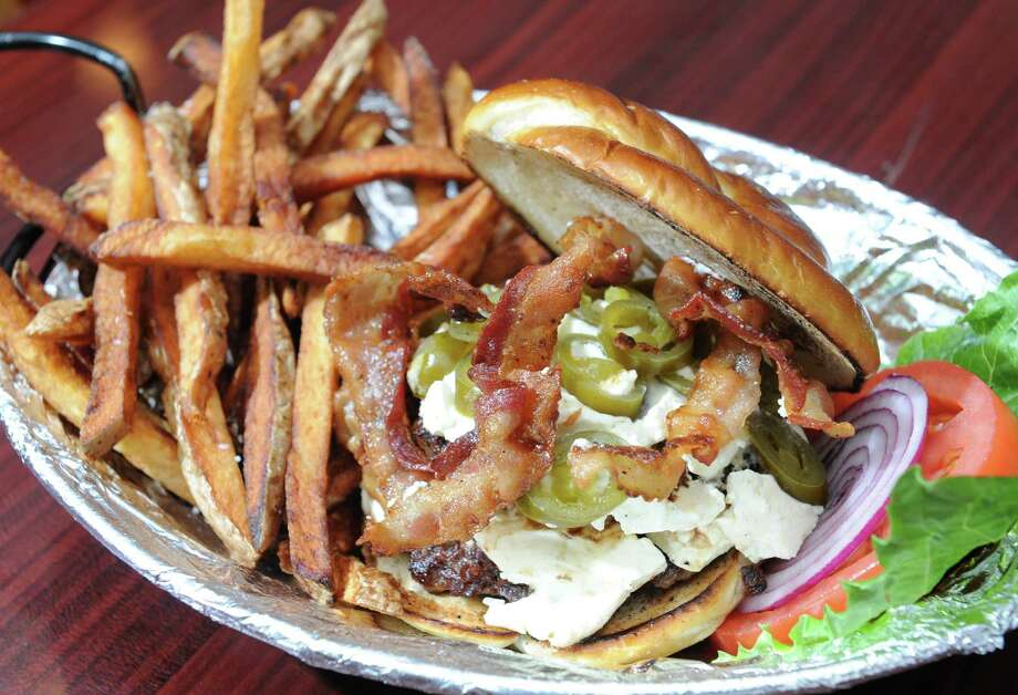 The Limbtwister burger at the Cask & Rasher on Monday, Sept. 23, 2013 in Coxsackie, N.Y.  (Lori Van Buren / Times Union) Photo: Lori Van Buren / 00023959A