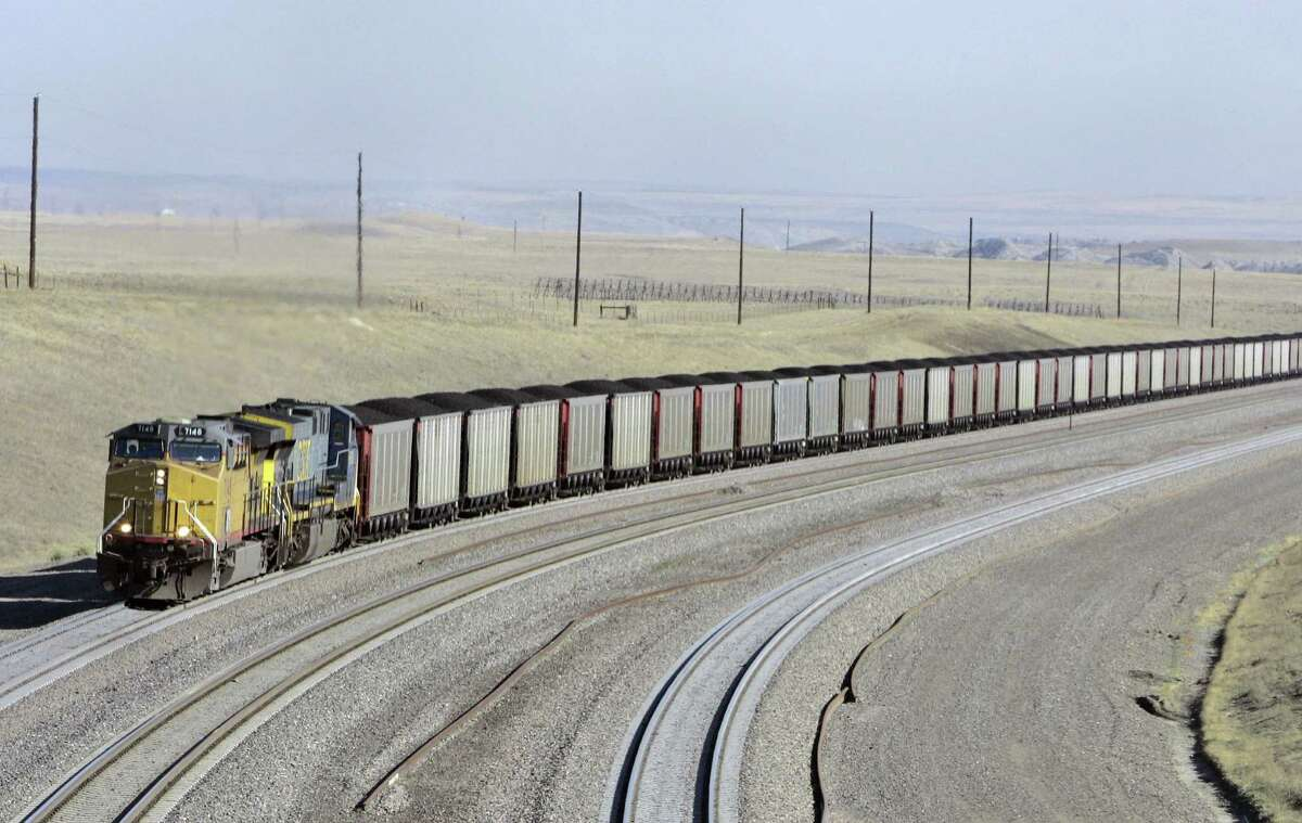 A coal train travels in northeast Wyoming. Tough new limits on the amount of carbon dioxide emissions that new power plants can emit, proposed by the Obama administration, will likely accelerate a shift away from coal-fired power.