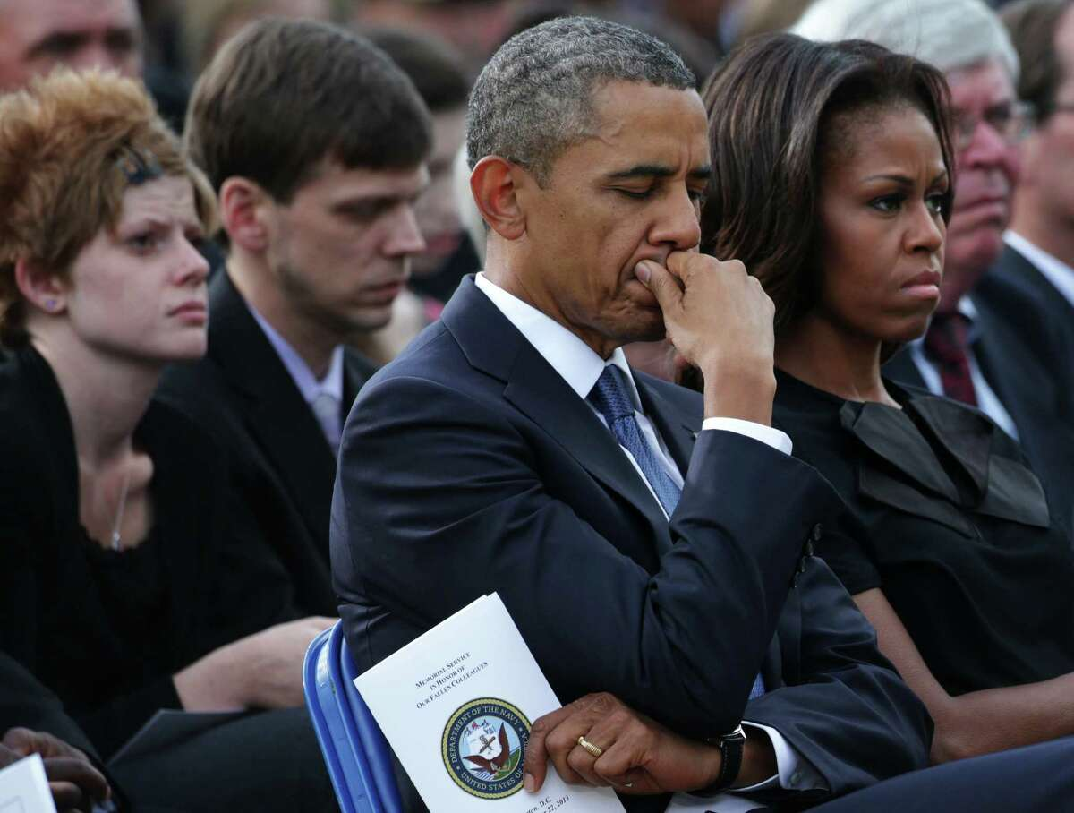 President Barack Obama and first lady Michelle Obama attend a memorial service for victims of the Navy Yard shooting. A reader suggests that Americans use their votes to enact changes in gun laws.