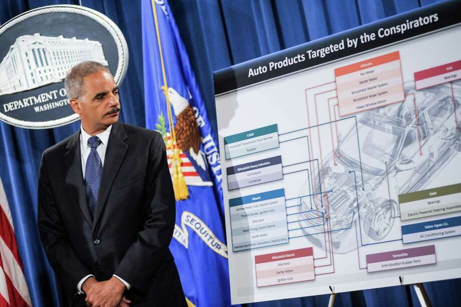 WASHINGTON, DC - SEPTEMBER 26: Attorney General Eric Holder speaks during a press conference on September 26, 2013 in Washington, DC. Holder announced antitrust law enforcement action against 20 automobile part manufacturers and 21 executives in price fixing and bid rigging in the auto parts industry at the Justice Department. (Photo by Kris Connor/Getty Images) ORG XMIT: 182111810 Photo: Kris Connor / 2013 Getty Images