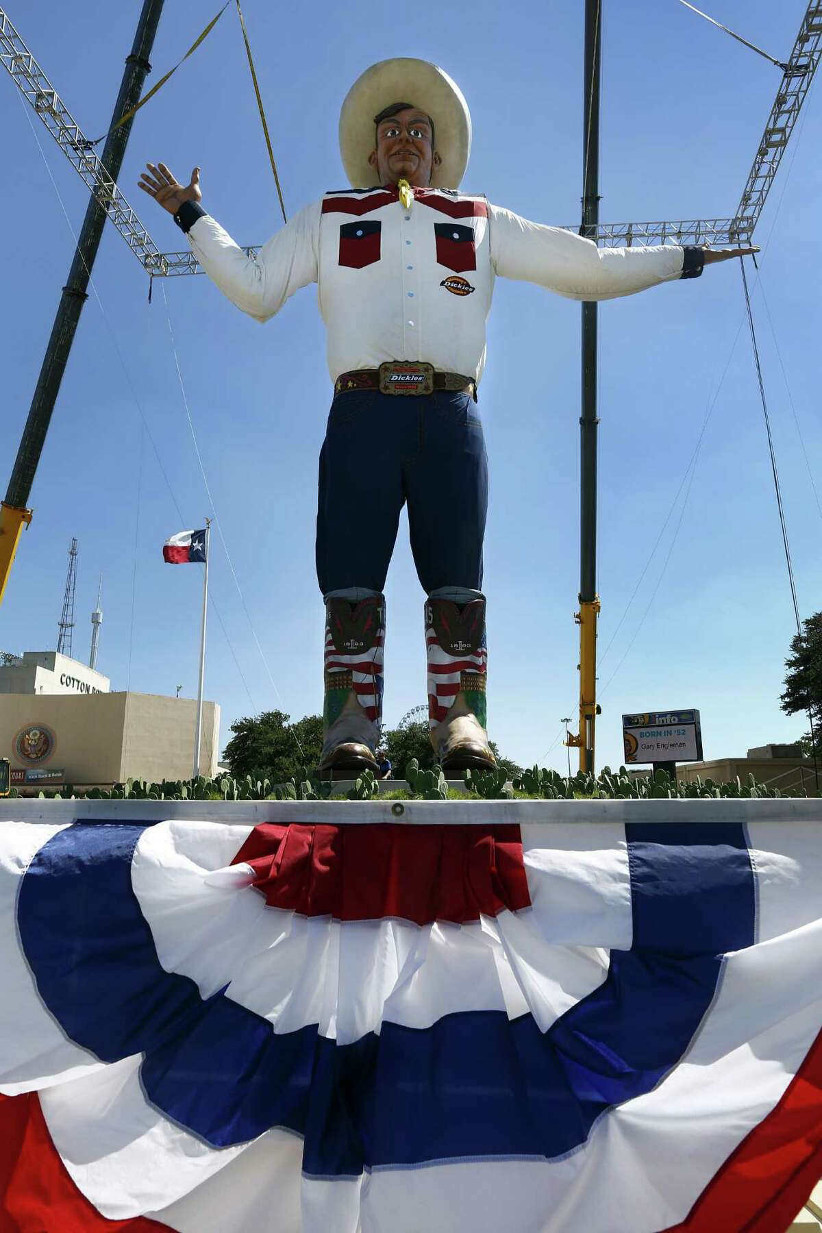 Because of high winds the curtain was dropped and the new Big Tex was revealed to the public a day earlier than expected at the State Fair of Texas, Thursday, September 26, 2013. He was erected in the middle of the night earlier today. (Tom Fox/Dallas Morning News/MCT)