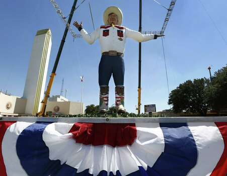 Because of high winds the curtain was dropped and the new Big Tex was revealed to the public a day earlier than expected at the State Fair of Texas, Thursday, September 26, 2013. He was erected in the middle of the night earlier today. (Tom Fox/Dallas Morning News/MCT) Photo: Tom Fox, McClatchy-Tribune News Service / Dallas Morning News