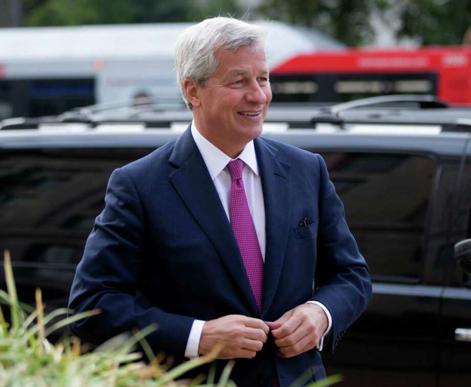 JPMorgan Chase Chairman, President and CEO Jamie Dimon, arrives at the Justice Department in Washington, Thursday, Sept. 26, 2013. An $11 billion national settlement is under discussion to resolve claims over JPMorgan's handling of mortgage-backed securities in the run-up to the recession, said a government official familiar with ongoing negotiations among bank, federal and New York state officials.  (AP Photo/Manuel Balce Ceneta) ORG XMIT: DCMC102 Photo: Manuel Balce Ceneta / AP