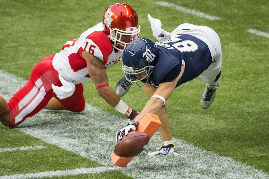 Sept 21: Houston 31, Rice 26Record: 1-2  Rice wide receiver Klein Kubiak stretches for the goal line as Houston defensive back Adrian McDonald  defends. Photo: Smiley N. Pool, Houston Chronicle