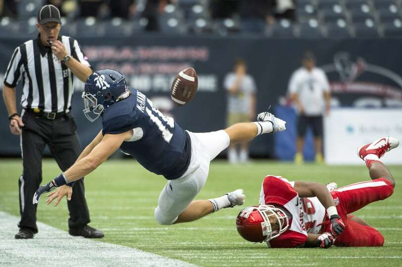 Rice quarterback Taylor McHargue fumbles the ball as he is knocked out of bounds by Houston defensiv