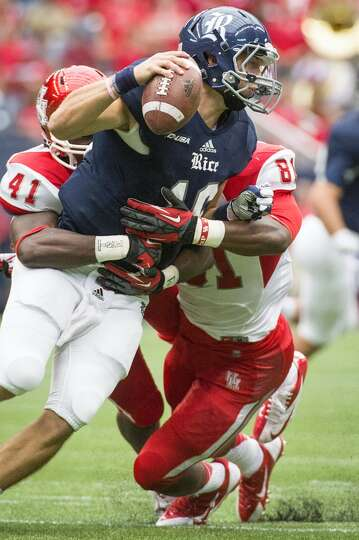 Rice quarterback Taylor McHargue (16) is sacked by Houston linebacker Steven Taylor (41) and defensi