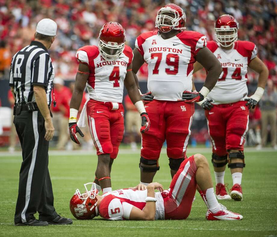 Houston quarterback John O'Korn (5) is slow to get up after a hit during the first half. Photo: Smiley N. Pool, Houston Chronicle