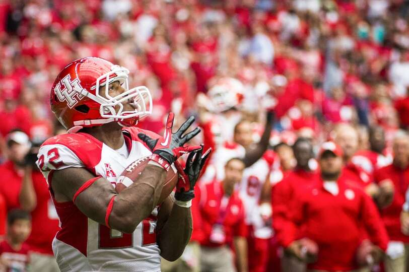 Houston running back Ryan Jackson catches a 32-yard touchdown pass during the fourth quarter. The to
