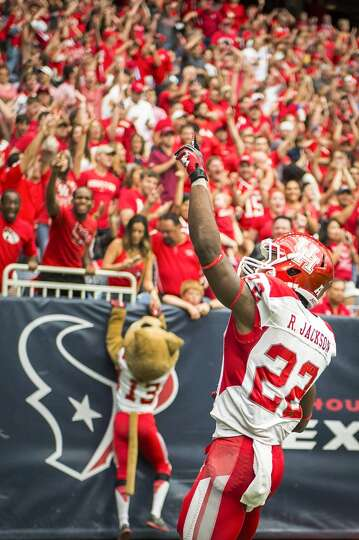 Houston running back Ryan Jackson celebrates after catching a 32-yard touchdown pass during the four
