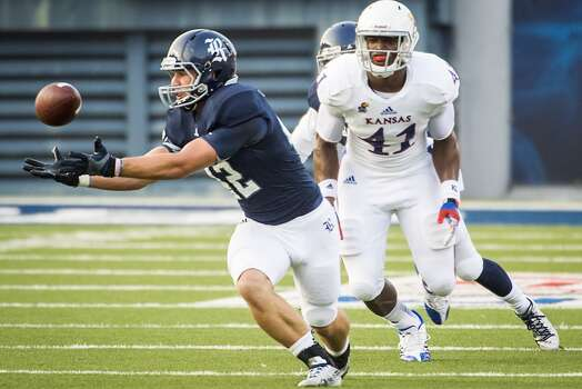Rice 23, Kansas 14Record: 1-1  Rice linebacker Michael Kutzler steps in front of Kansas tight end Jimmay Mundine to intercept a pass and return it 52-yards for a touchdown. Photo: Smiley N. Pool, Houston Chronicle
