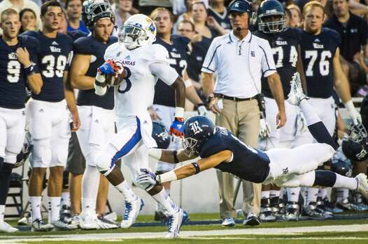 Kansas running back Tony Pierson gets past the final defender, Rice cornerback Phillip Gaines, on a 77-yard touchdown reception. Photo: Smiley N. Pool, Houston Chronicle