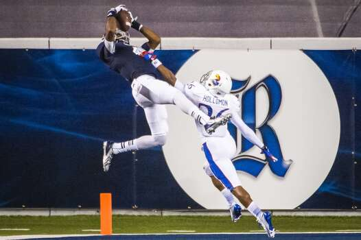 Rice wide receiver Dennis Parks beats Kansas cornerback Brandon Hollomon but can't come down with his feet in bounds for a touchdown. Photo: Smiley N. Pool, Houston Chronicle