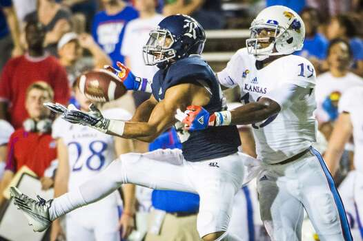 Rice cornerback Bryce Callahan intercepts a pass intend for Kansas wide receiver Justin McCay. Photo: Smiley N. Pool, Houston Chronicle