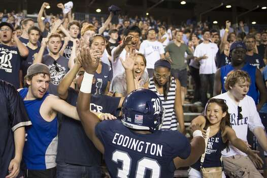 Rice's Jeremy Eddington celebrates with the crowd after a win over Kansas. Photo: Smiley N. Pool, Houston Chronicle