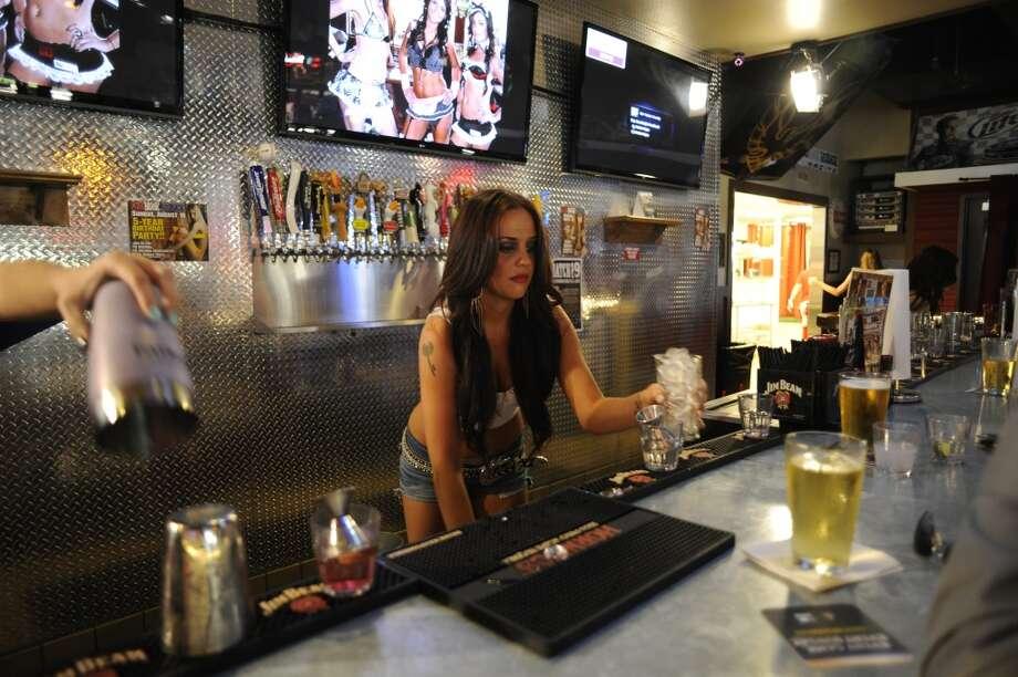 Kristyn works the bar. Photo: Matt Strasen, Invision For MTV
