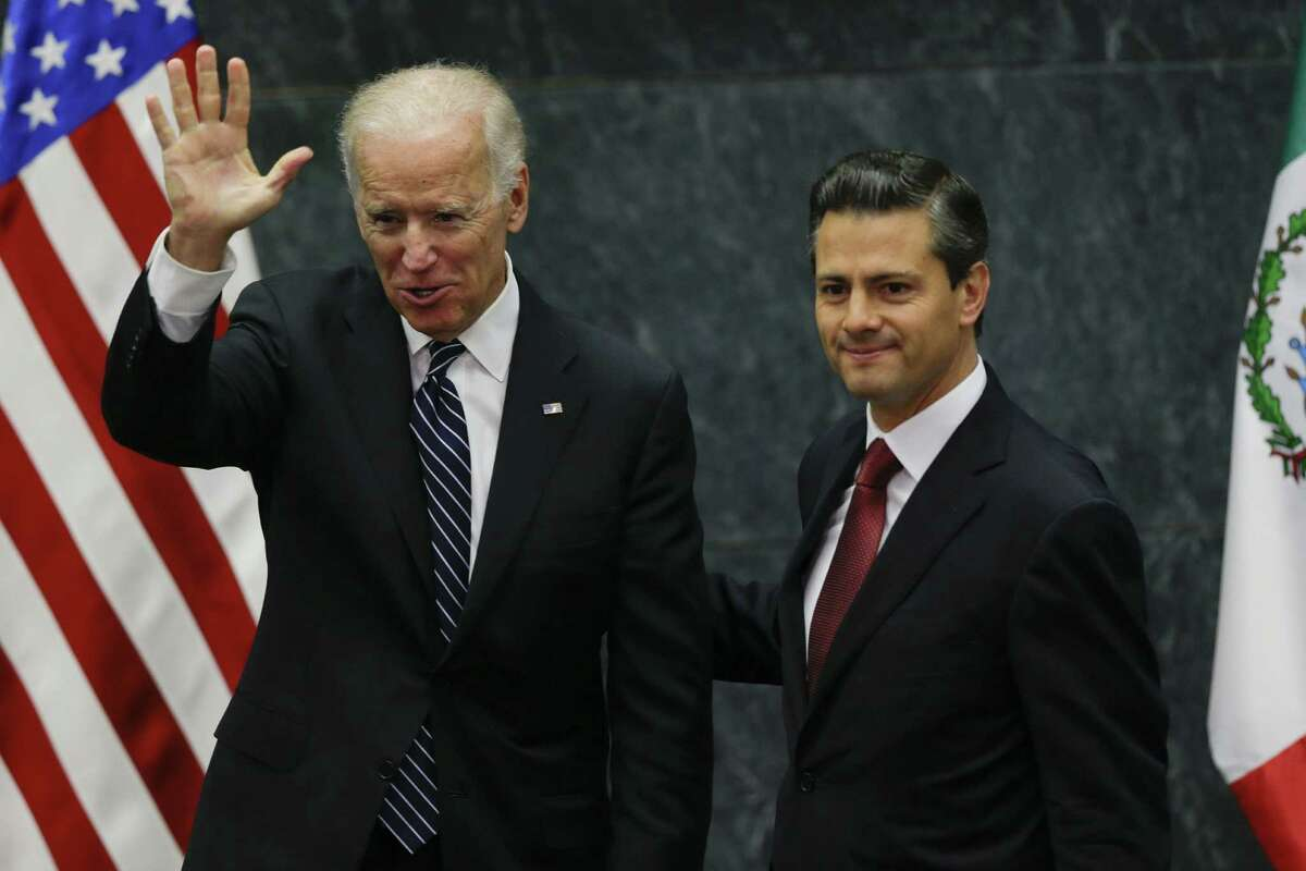 Vice President Joe Biden accompanies Mexico President Enrique Peña Nieto during a recent meeting in Mexico City. U.S. and Mexican leaders must work together to prepare for a likely boom in shale oil and gas production in Mexico.