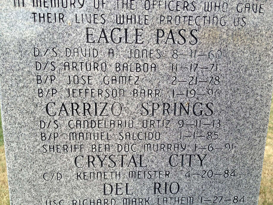 Etched on a tombstone memorial in Eagle Pass are the names of  law enforcement officers killed in the line of duty. The first name under Carrizo Springs is Candelario Ortiz. Photo: Courtesy