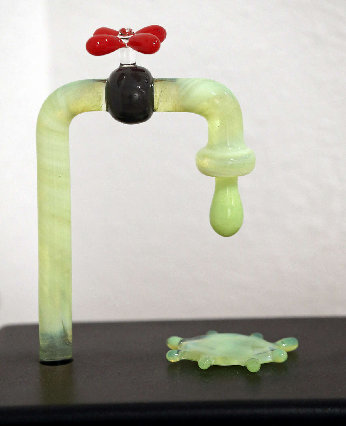 Sean Johnston's blown-glass faucet is featured in the Fl!ght Gallery, which is celebrating its 11th anniversary.