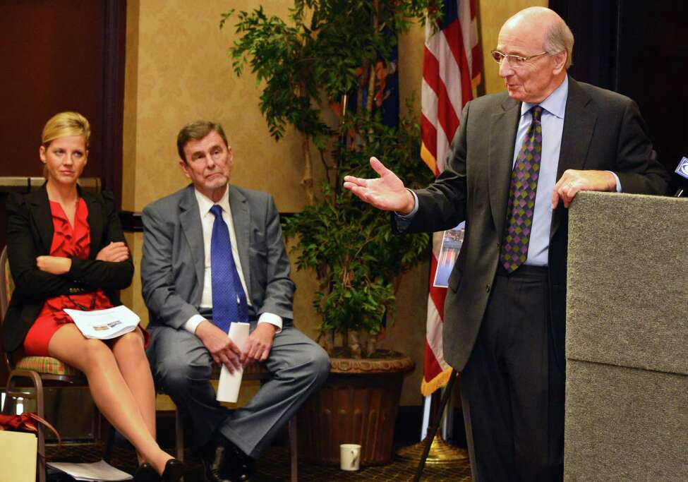 David Swawite, president and CEO of Omni Development, right, is joined by consultants Elena Kazlas, left, and Thomas Martin of ConsultEcon during a news conference where a feasibility study on building an aquarium in Albany was to unveiled Thursday afternoon, Sept. 26, 2013, at the Hampton Inn and Suitesin Albany, N.Y. (John Carl D'Annibale / Times Union)