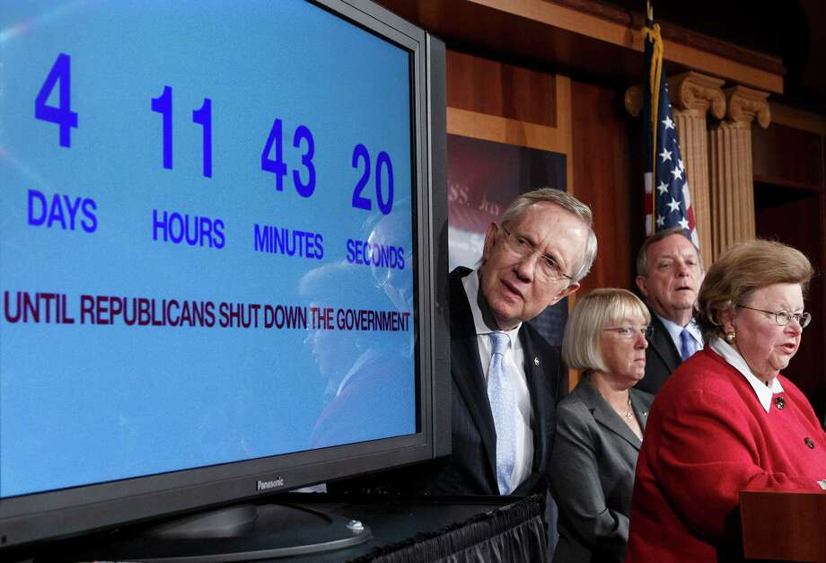 With days to go before the U.S. government is due to run out of money, Senate Majority Leader Harry Reid, D-Nev. (left), checks the countdown clock. A reader takes congressional leaders to task for their lack of accomplishment. Photo: J. Scott Applewhite, Associated Press / AP