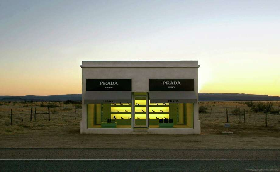 File - This Jan. 10, 2006, file photo, shows the stucco and adobe Prada Marfa, near Valentine, Texas. Texas officials say the Prada Marfa is an illegal roadside advertisement and is considering what to do about the iconic West Texas structure. The Prada Marfa was installed in 2005, but it only came under scrutiny this summer after Playboy installed a 40-foot sign with a neon-lit bunny not far from the famous building. The state ordered Playboy to remove its sign within the next month. Photo: Matt Slocum