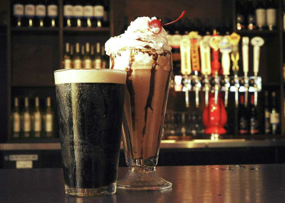 The Guinness Milkshake at Olmos Pharmacy is made with chocolate ice cream and is topped with a cherry.