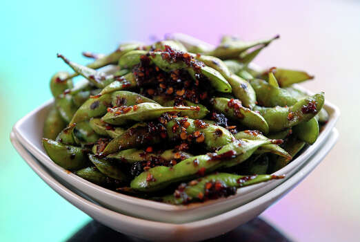 "Edamame (ed-dah-MAH-may): The Japanese word for immature soybeans. Audio: Click here to hear the term ""Edamame."" Photo: TOM REEL"